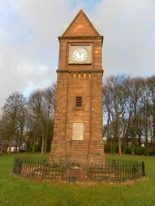 The cross base is at the foot of the clock tower in Victoria Park