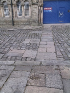 The flat paving shows the line of the moat wall and buttresses